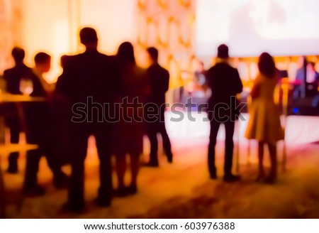 blurred people and waiter on gala dinner party in ballroom Stockfoto ©