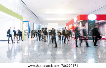 blurred people at a trade fair hall