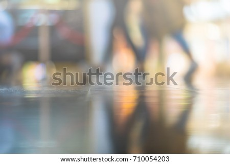 Blurred people at shopping mall background go shopping. Empty floor can be used as copy space for you text. - Shutterstock ID 710054203