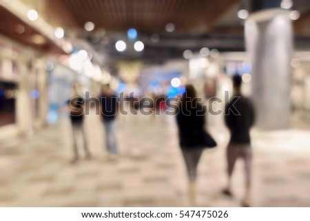 blurred people at shopping mall ...