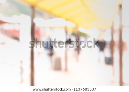 Blurred people at waiting zone in airport or bus station with bokeh for background usage . (vintage tone) #1137683507