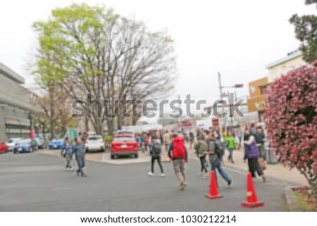 Blurred people cross the crosswalk in rush hour at Tokyo.