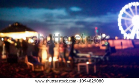 Blurred people having sunset beach party in summer vacation - Defocused image - Concept of nightlife with cocktails and music entertainment