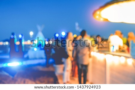 Blurred people having sunset beach party in summer vacation - Defocused image - Concept of nightlife with cocktails and music entertainment #1437924923