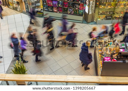Blurred people in motion blur, rushing in the lobby of shopping mall. View from above. #1398205667