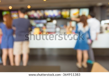 Blurred people order fast food for background. #364911383