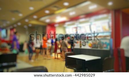 blurred people order fast food restaurant #442985029