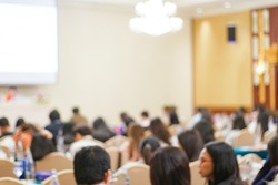 Blurred people sitting in business seminar room in hotel business background