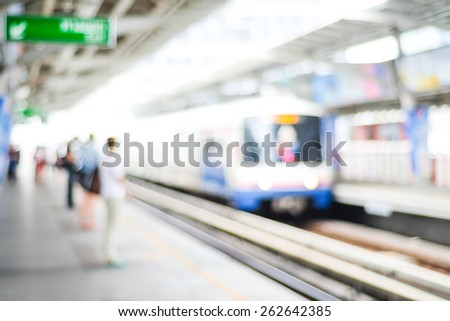 Blurred people waiting for subway at station, transportation background