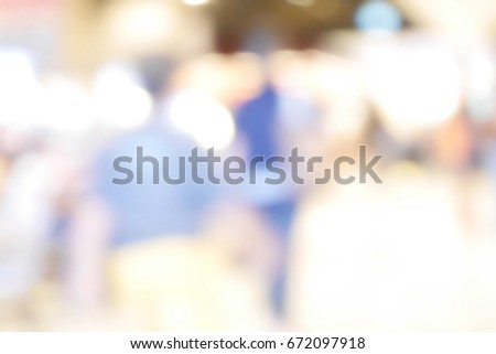 Blurred people walking #672097918