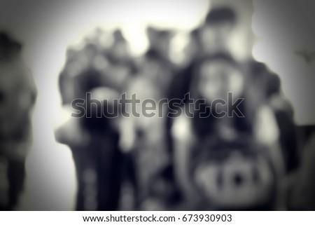 Blurred people walking #673930903