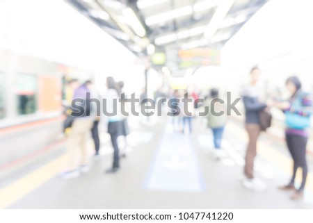 Blurred people walking in train station hurry up #1047741220