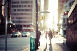 Blurred people walking on the street of Vancouver at sunset