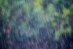 blurred photo,A lot of rain is falling from the sky because of the rain storm coming into the area as the Department of Sound has warned that there will be heavy rains and beware of the floods quickly