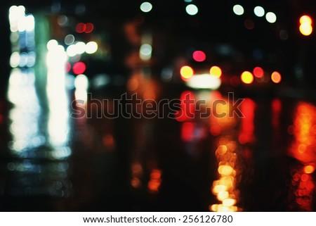 blurred photo background, road red lights, rainy night