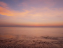 Blurred photo, Beautiful seascape with motion blur sky and sea at sunset background.Using as background or natural wallpaper.Nature composition concept.