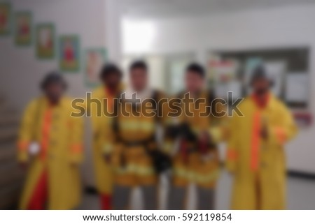 blurred photo,Blurry image, The team of firemen His mission #592119854