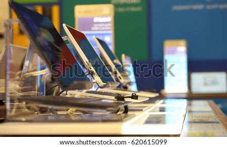 Blurred photo of a computer shop interior,displayed modern electronic devices in England.