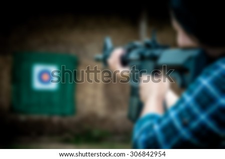 Blurred photo of a woman shooting at a target.