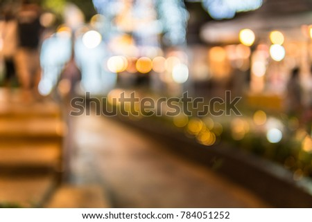 Blurred photo of Christmas lights. Festive New-year background with bokeh from Christmas tree lights glowing. Blurred colorful circles on light holiday background. #784051252