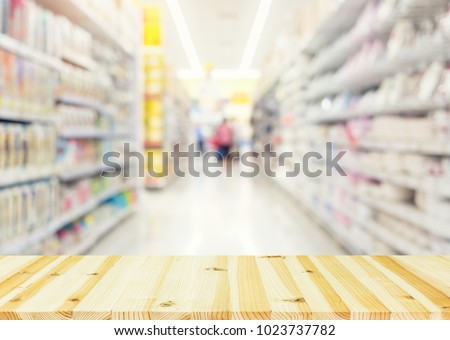 Blurred photo of products in shelf for shopping background. #1023737782