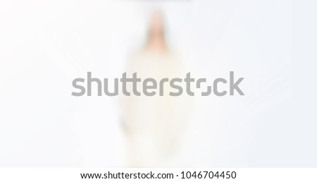 Blurred photo of Resurrection of Jesus.Jesus stand and resurrection sunday. Religious Easter background.