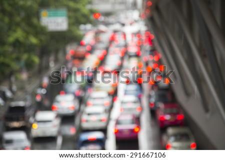 Blurred photo of  traffic jam in rainy day. Bangkok Thailand.