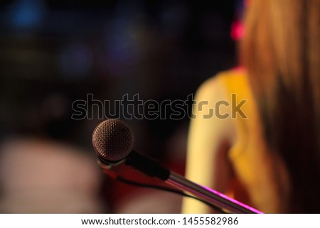 blurred photo,The microphone was prepared for the singer to perform on-stage singing in a nightclub to add fun to tourists with music and music from singers who sang the song. #1455582986