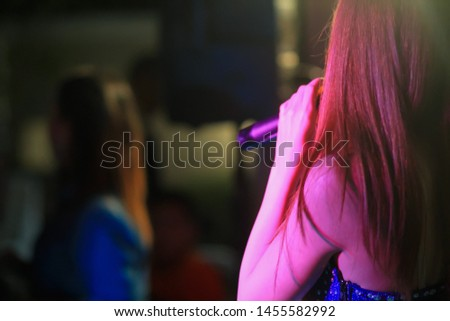 blurred photo,The microphone was prepared for the singer to perform on-stage singing in a nightclub to add fun to tourists with music and music from singers who sang the song. #1455582992
