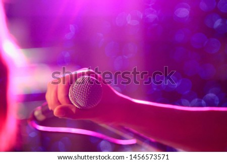 blurred photo,The microphone was prepared for the singer to perform on-stage singing in a nightclub to add fun to tourists with music and music from singers who sang the song. #1456573571