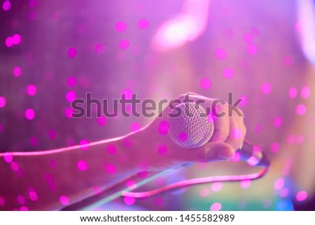 blurred photo,The microphone was prepared for the vocalist to perform on-stage singing in the nightclub to add fun to tourists with music and vocalist songs that sang. #1455582989