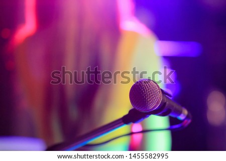 blurred photo,The microphone was prepared for the vocalist to perform on-stage singing in the nightclub to add fun to tourists with music and vocalist songs that sang. #1455582995