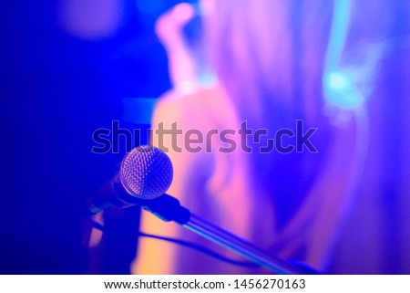 blurred photo,The microphone was prepared for the vocalist to perform on-stage singing in the nightclub to add fun to tourists with music and vocalist songs that sang. #1456270163