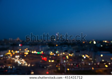 Blurred picture of night city lights under a deep blue sky