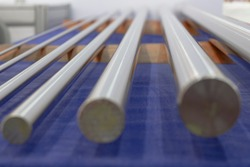 blurred picture of Round stainless steel bars from grinding process ; industrial engineering background