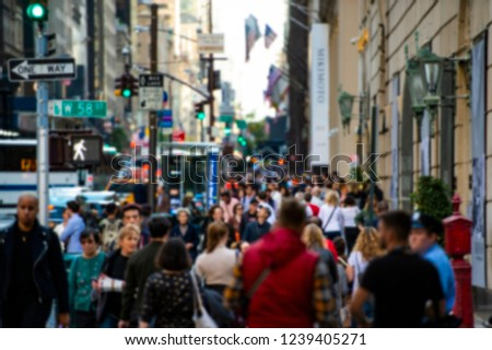 Blurred picture of tourists walks on the 5th avenue in New York, Manhattan, USA. Fifth Avenue is a major thoroughfare in the borough of Manhattan in New York City.