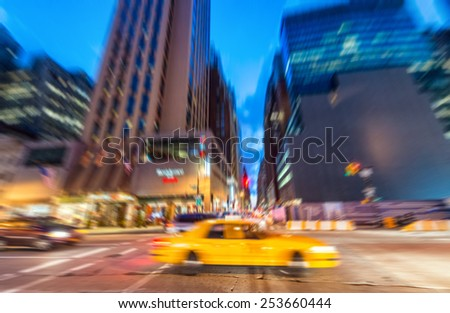 blurred picture of yellow cab...