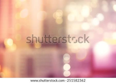 Blurred pink and orange urban building background scene