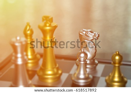 Blurred players out of focus in chess battle for business competition concept.  Aggression and strength, competitive edge.  Copy space room in top corner. #618517892