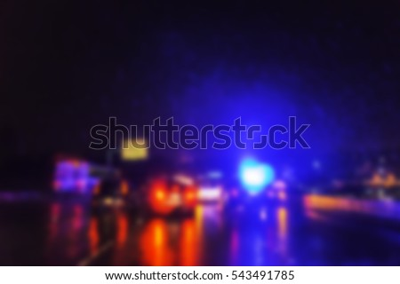 blurred police lighting in the dark.