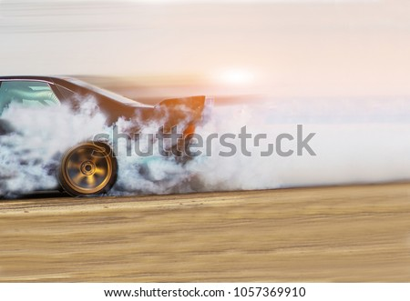 Blurred Race car drifting on speed track