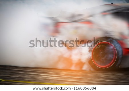Blurred Race car drifting on speed track on twilight background. #1168856884
