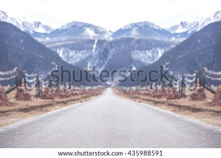blurred road to snow mountain...