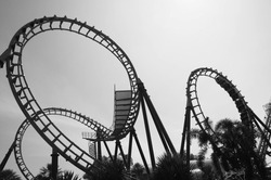 blurred Roller coaster ride in amusement park with black and white effect