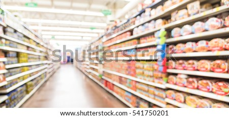 Blurred selection of pasta, ketchup, condiment, tomato sauce and canned vegetable on shelves in store at Humble, Texas, US. Aisle, row variety product, defocused background, bokeh light. Panorama view