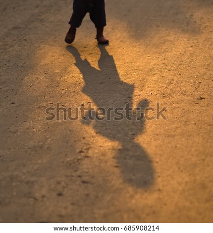Blurred Shadow child playing and runing on background kid family girl silhouette nature summer fun sport joy play active concept happy playground freedom
