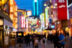 Blurred Shinsekai district of Osaka. The area is a famed nightlife district