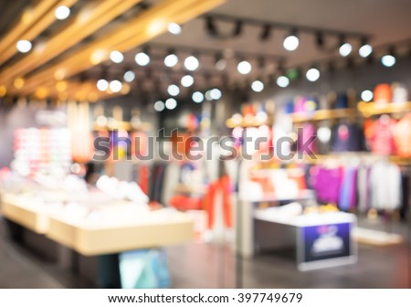 Blurred showcases fashion boutique with sportswear . Blurred bokeh basic background for design.