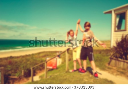 Blurred Siblings Freedom Beach Summer Holiday Concept background. #378013093