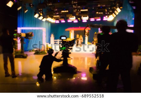 blurred silhouette cameraman with  staff in TV studio station